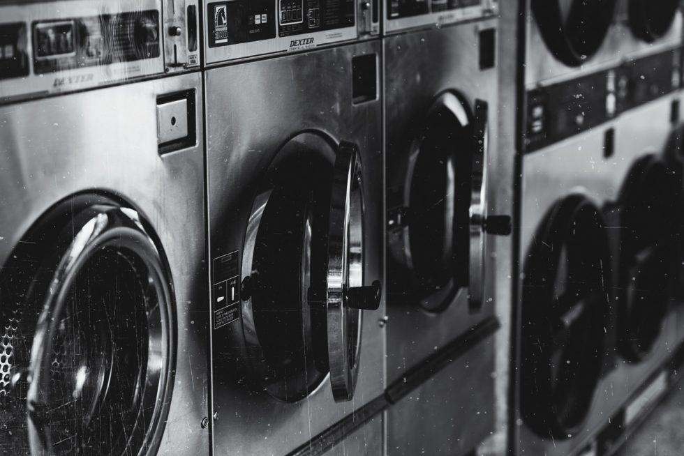 grayscale-shot-washing-machine-with-opened-doors