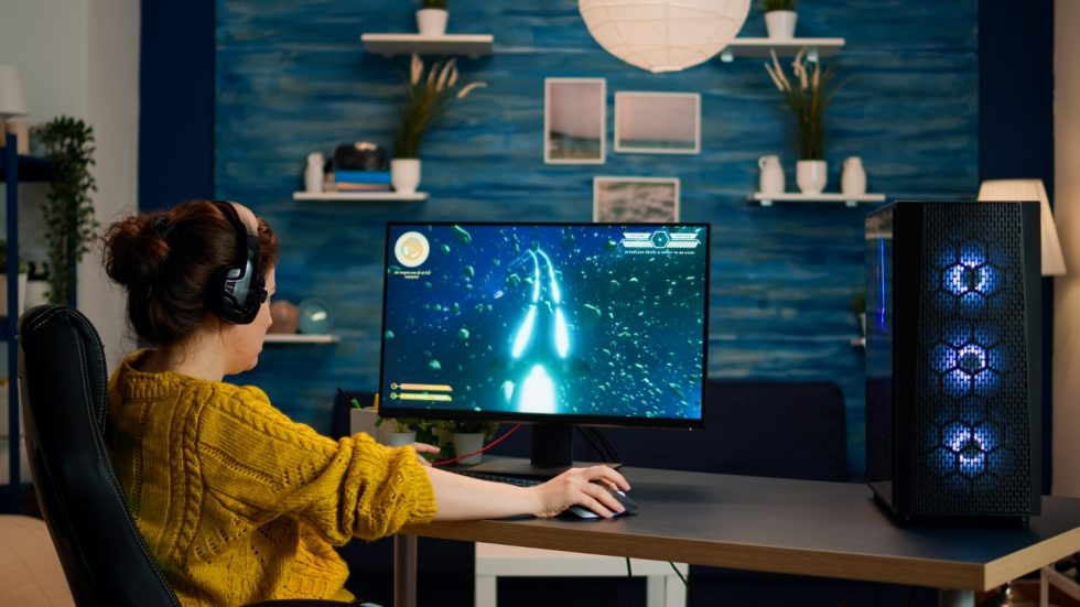 professional-gamer-playing-first-person-shooter-online-video-game-powerful-personal-computer-with-colorful-neon-led-lights-cyber-performing-pc-stylish-room-during-gaming-tournament