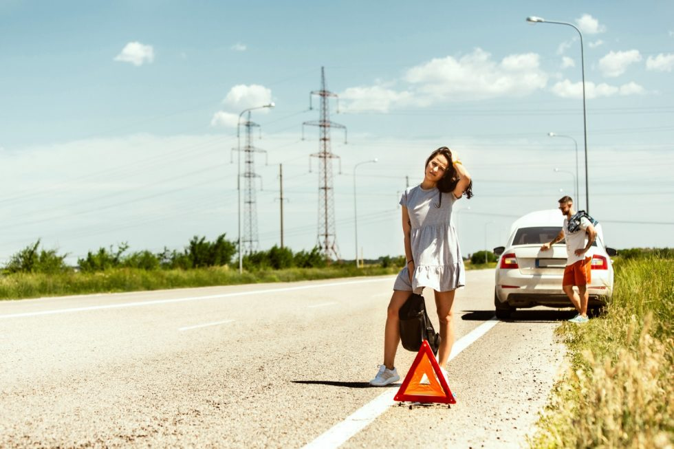 young-couple-broke-down-car-while-traveling-way-rest