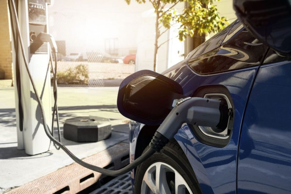 electric-car-recharging-in-charging-station-royalty-free-image-1591371729